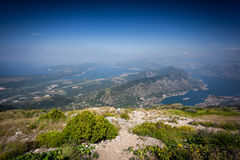 Panoramic shot from top of mountain on bay and blue sky Royalty Free Stock Photos