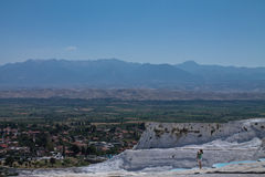 Panoramic sight on mountains and natural hot springs with limestone in touristic destination cotton castle pamukkale, turkey Stock Photos