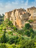 Panoramic sight of Pitigliano in a sunny summer afternoon. Province of Grosseto, Tuscany, Italy. Pitigliano is a town in the province of Grosseto, located about Royalty Free Stock Photo