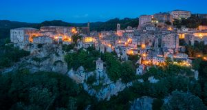 Panoramic sight of Sorano in the evening, in the Province of Grosseto, Tuscany Toscana, Italy. Sorano is a town and comune in the province of Grosseto, southern stock photography