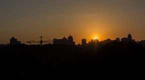 Panoramic silhouette of a big city at sunset Royalty Free Stock Images