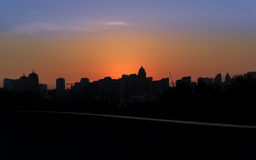 Panoramic silhouette of a big city at sunset. Kiev Royalty Free Stock Photo