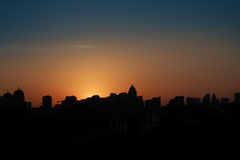 Panoramic silhouette of a big city at sunset Stock Image