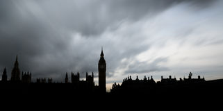 Panoramic silhouette of The Houses of Parliament and the Big Ben in London. Panoramic long exposure of The Houses of Parliament, the Big Ben and Westminster Stock Photo
