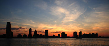 Panoramic Silhouette Skyline. Sunset across the Hudson River Royalty Free Stock Image