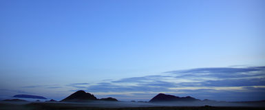 Panoramic Silhouetted Misty Landscape Stock Photography