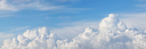 Panoramic sky with beautiful cumulus clouds Stock Photography