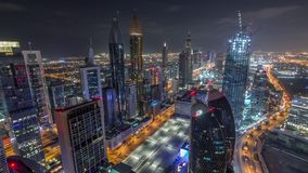 Skyline of the buildings of Sheikh Zayed Road and DIFC aerial night timelapse in Dubai, UAE. Panoramic skyline of the buildings near Sheikh Zayed Road and DIFC stock footage