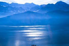 Panoramic skyline view of Swiss Alps and lake Royalty Free Stock Photography