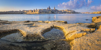 Panoramic skyline view of Valletta, the capital of Malta. Shot from Sliema waterfront Stock Photo