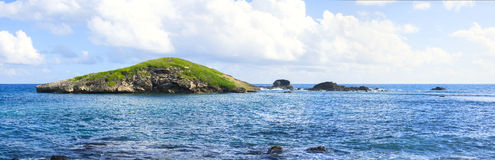 Panoramic of small rocky cay in Caribbean Stock Photos