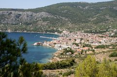 A panoramic snapshot fishing village of Lumbarda on island of Vis. The panoramic snapshot of fishing village of Lumbarda with view to red roofs, harbor and Stock Photography
