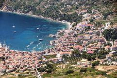 A panoramic snapshot fishing village of Lumbarda on island of Vis. The panoramic snapshot of fishing village of Lumbarda with view to red roofs, harbor and Royalty Free Stock Images