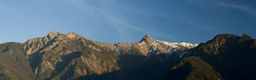 Panoramic snow mountain peak in dawn. Royalty Free Stock Photos