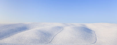 Panoramic snow rolling hills landscape in winter. Tuscany, Italy. Panoramic snow rolling hills landscape in winter and blue clear sky. Tuscany, Italy Royalty Free Stock Photos
