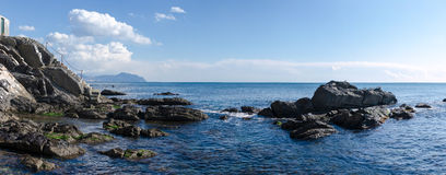 Panoramic stairway to the sea. Overview of the rocks in Genoa Boccadasse Royalty Free Stock Images