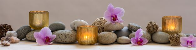 Panoramic still life for harmony in spa, massage or yoga. Panoramic indulging still life for harmony and balance in spa, massage, yoga or feng shui with mineral royalty free stock image