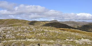 Panoramic from a stony Hart Crag across to Fairfield, Lake District. View from a stone covered area by Hart Crag with Fairfield running off to the left and royalty free stock photos