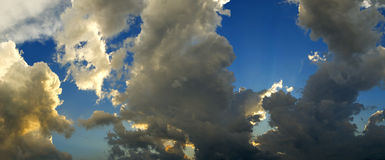 Panoramic of stormy sky. A panoramic of a stormy sky with black and orange clouds Royalty Free Stock Photos