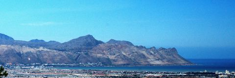 Panoramic of Strand, South Africa. Panoramic, overhead view of Table Bay and the suburb of Strand, near Cape Town, South Africa, with mountains in the background royalty free stock photography