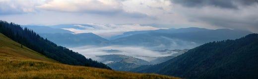 Panoramic sunrise foggy mountains Stock Photo