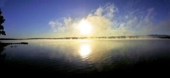 Panoramic - sunrise over lake with haze Royalty Free Stock Image