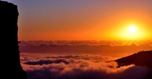 Panoramic sunrise over the sea of clouds Stock Image