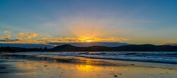 Panoramic Sunrise Seascape and Crepuscular Rays. Taken at Umina Beach, Central Coast, NSW, Australia Stock Images