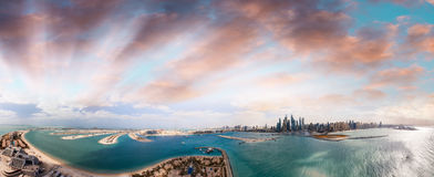 Panoramic sunset aerial view of Palm Jumeirah and Dubai Marina - Stock Photography