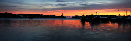 Panoramic Sunset And Lighthouse Royalty Free Stock Images