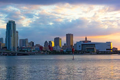 Panoramic sunset with bodies of water and city landmarks. Stock Images