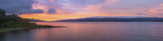 Panoramic Sunset. A gorgeous panoramic view of Lake Arenal, Costa Rica during sunset Royalty Free Stock Image