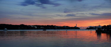Panoramic sunset and lighthouse Stock Photography