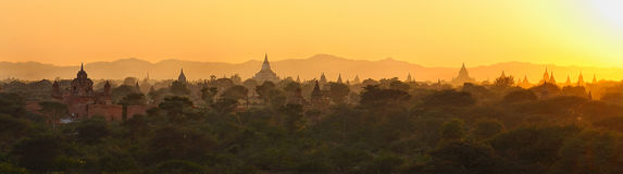Panoramic sunset over bagan,myanmar. Panoramic view of the Sun setting over the ancient stupas of bagan,myanmar Royalty Free Stock Photography