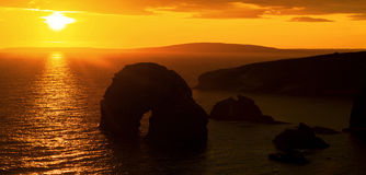 Panoramic sunset over the virgin rock Royalty Free Stock Photography