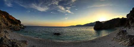 Panoramic sunset. A panorama fish eye like view of the sunset on Aghiofili beach, Lefkada Greece Stock Image