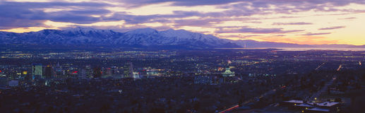 Panoramic sunset of Salt Lake City with snow capped Wasatch Mountains royalty free stock photography