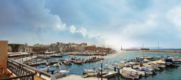 Panoramic sunset at the Venetian Lighthouse at Chania. Crete Island Royalty Free Stock Images
