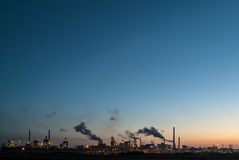 Panoramic sunset view of a large industry area Royalty Free Stock Photos