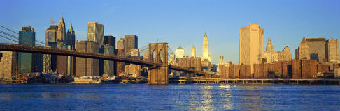 Panoramic sunset view of Manhattan towards Queens over East River, New York City, NY Royalty Free Stock Images