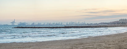 Panoramic sunset view port in the Valencia harbor cranes transport From the beach Royalty Free Stock Image