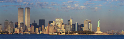 Panoramic sunset view of World Trade Towers, Statue of Liberty, Brooklyn Bridge, and Manhattan, NY skyline Stock Photos