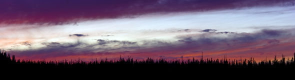 Orange and Purple Hues Long Panoramic Sunset in the Wilderness Stock Images