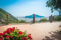 Small square in Sorrento with beautiful view. Panoramic terrace with flowers, overlooking to Capri, in Sorrento, Localita Termini stock images