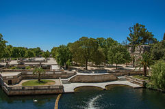 Panoramic of the 18th-century Gardens of the Fountain, built around the Roman thermae ruins, in Nimes. royalty free stock images