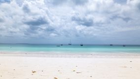 Panoramic Timelapse of white sand tropical beach. Panoramic longexposure Timelapse of white sand tropical beach with turquoise water, coconut trees swaying in stock video footage