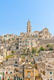 Panoramic of tipical stones and church of Matera Stock Images
