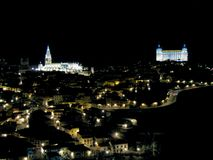 panoramic of Toledo at night with stock image