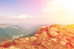 Panoramic toned view over the Carpatian mountains and Sinaia tow Stock Photo