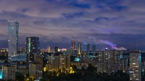Panoramic view of Moscow timelapse. Panorama of a big city at night. Residential buildings on Mosfilmovskaya street stock footage